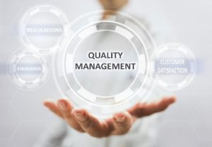 hands presenting quality management
