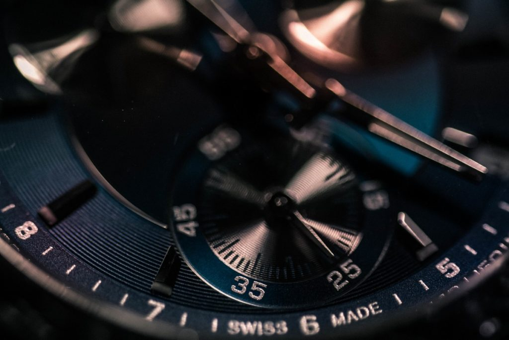 A close up shot of the face of a Swiss made watch.