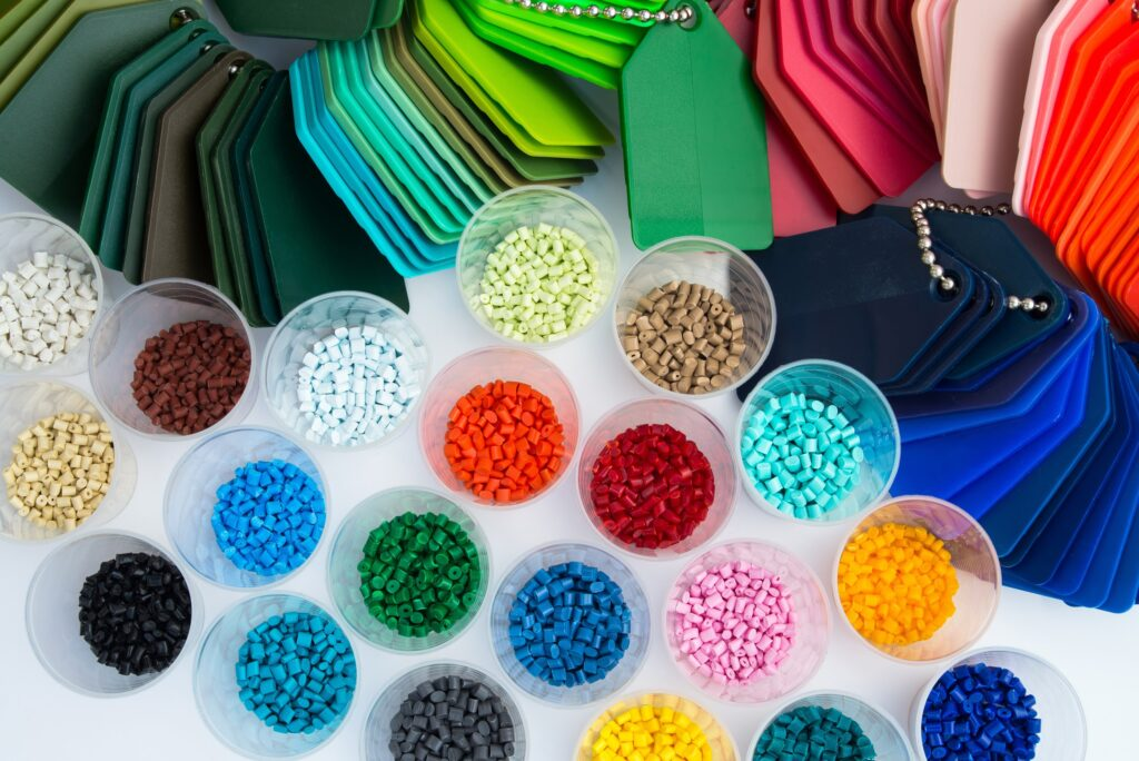 several dyed plastic polymer granulates in laboratory